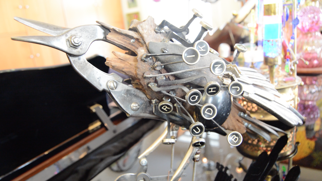 Typewriter keys and wire snippers repurposed into bird sculpture