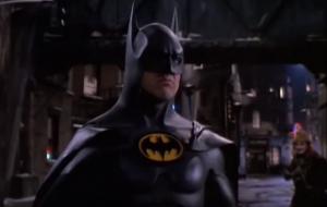 Tim Burton's Batman, wearing an intimidating jet black suit made of rubber.